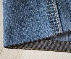 Обработка низа джинсов брючной лентой